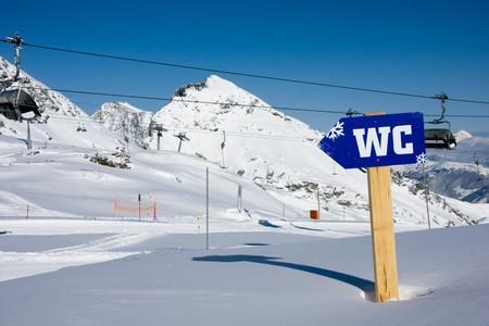 WC sign under high mountains. Kaprun, Austria. photo