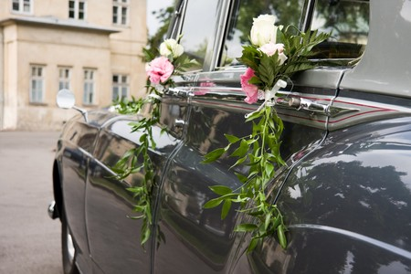 Luxury antique wedding car decorated by rose flowers photo
