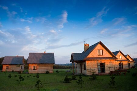 Group of wooden houses in a red light of sunrise Stock Photo - 4581563