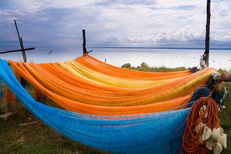 Colorful fishing nets drying oa a sea shore. photo