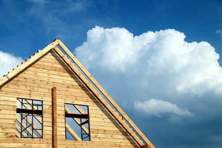 Windows in a new wooden house over blue sky with clouds Stock Photo - 4677534