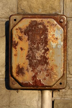 voltage gray: Old rusty eletrical box on a wall Stock Photo