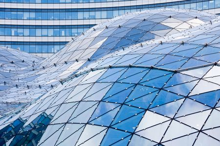 poland: Blue roof in modern building made of glass and steel Stock Photo