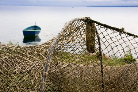 Old fishing nets drying on a sea shore photo