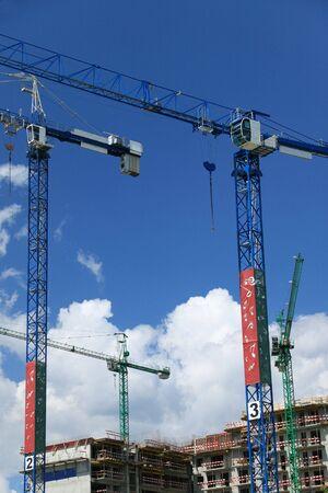Construction cranes against blue sky Stock Photo - 4755292