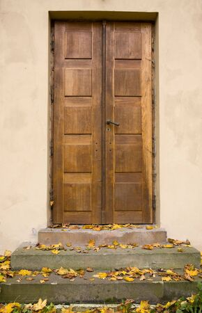 Traditional wooden doors in old house  photo