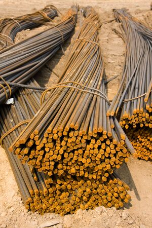 Lots of rusty metal rods on a ground photo