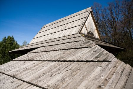Wide angle image of tradition polish wooden roof in old cabin. photo