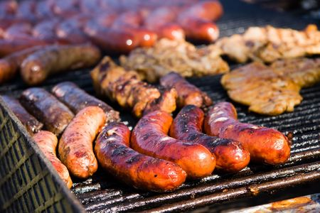 Sausages and other kinds of meat on a barbecue Stock Photo - 4999481