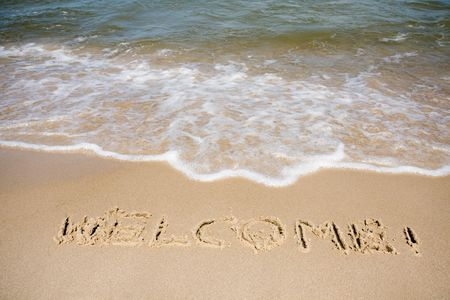Word welcome written in a sandy tropical beach Stock Photo - 4999488