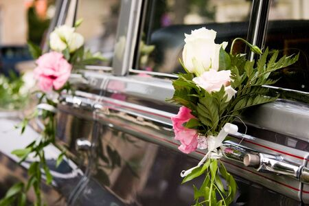 Luxury wedding car decorated with flowers photo
