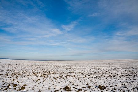 Cultivated field fully covered by snow in winter photo
