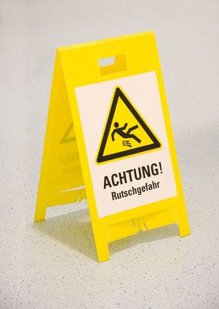 mopped: Wet floor warning sign in german Stock Photo