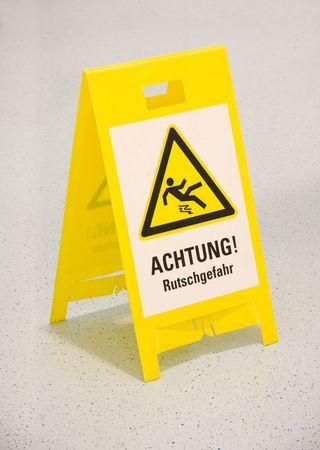 Wet floor warning sign in german Stock Photo