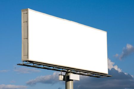 Blank billboard on blue sky with clouds ready for your advertisement photo