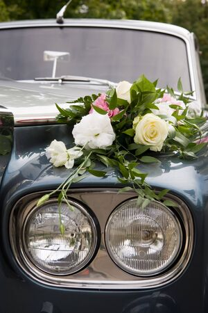 Luxury wedding car decorated by flowers Stock Photo
