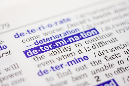 thesaurus: Dictionary definition of word determination in blue color Stock Photo