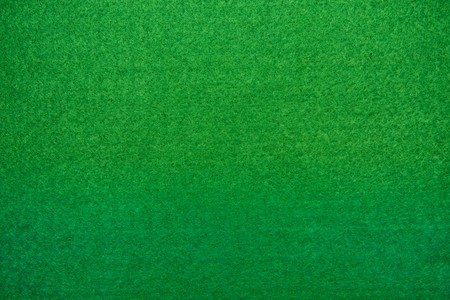 Close-up of green poker table felt background photo