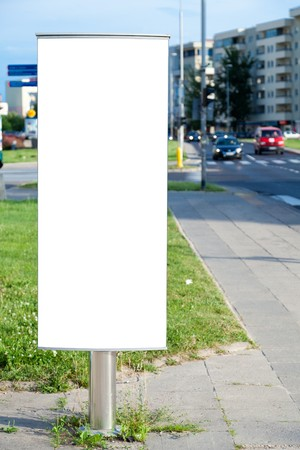 billboard posting: Vertical blank billboard useful for advertising in a city Stock Photo