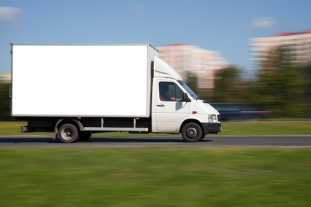 fast delivery: Panning image of truck with blank space for your adretisement Stock Photo