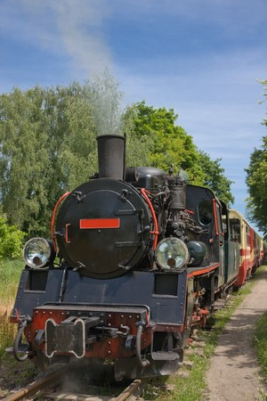 Vintage steam engine locomotive train moving down railroad Stock Photo - 7918379