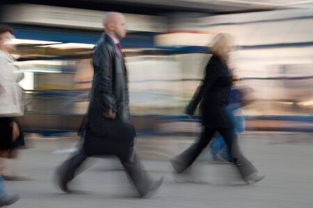 rushing hour: Blurred image of people rushing to work in the morning