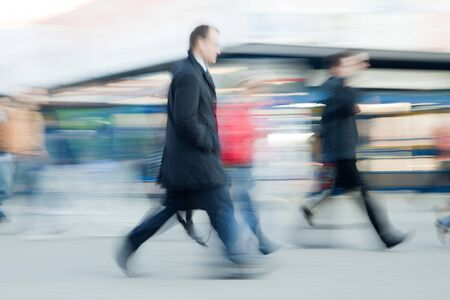 rush hour: Blurred image of people rushing to work in the morning