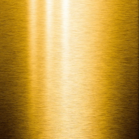 Brushed gold metal plate with reflections on the surface, useful for backgrounds