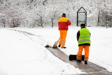 Workers removing first snow from pavement Stock Photo - 8595305