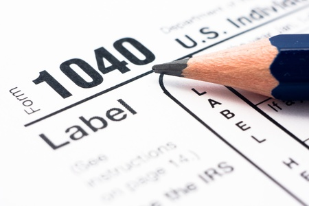 filling in: Filling in tax form 1040 for year 2010