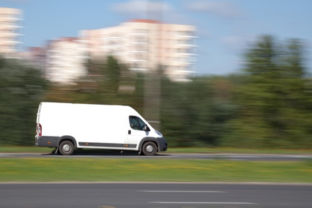 fast delivery: Panning image of delivery van with blank space for your advetisement