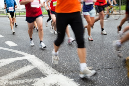 intentional: People running in marathon on a street in intentional motion blur