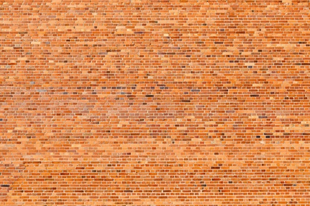Huge old brick wall background. Up to 65 bricks horizontaly.  photo