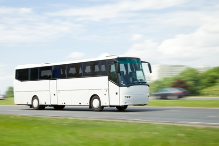 Panning image of tour bus in intentional motion blur Stock Photo