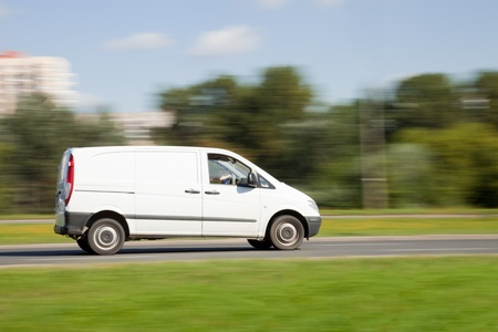 White van on road in intentional motion blur photo