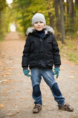 Smiling boy on path in autumn forest Stock Photo - 10671762