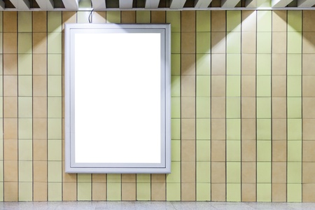 Blank billboard on a wall in subway underground with copy space  photo