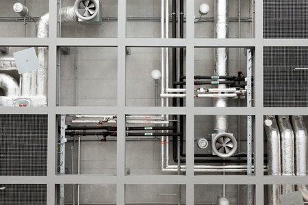 Industrial background of pipes and fans on ceiling photo