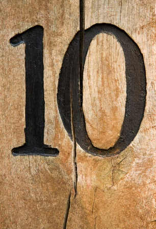 10: Number ten on craced wood desk