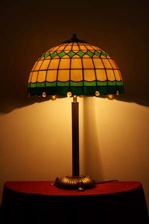 lampshade: Stained glass lamp on a table Stock Photo