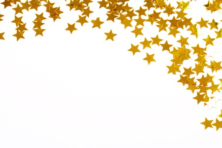 Golden confetti stars against white background as christmas decoration photo