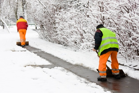 Workers removing first snow from pavement Stock Photo - 10885780