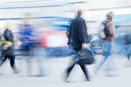 rushing hour: Blurred image of businessman rushing to office in the morning Stock Photo