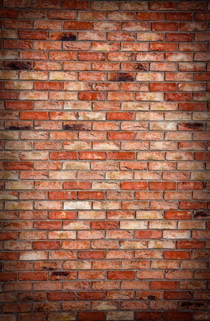 brick facades: Old and dark brick wall texture background Stock Photo