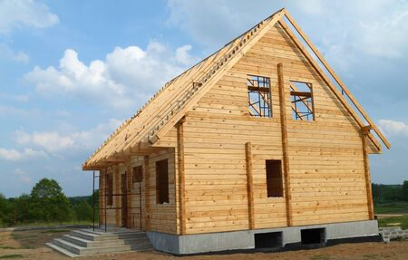New wooden house over blue sky photo