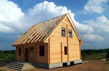 New wooden house over blue sky Stock Photo - 11060213