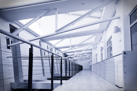 Toned image of empty corridor in modern office building photo