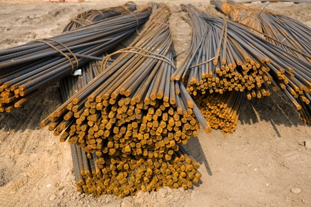 reinforcing bar: Lots of rusty metal rods on construction site Stock Photo