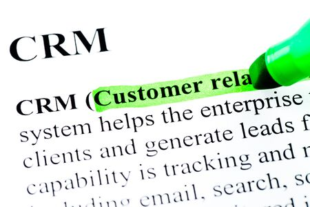 definition: CRM customer relationship management definition highlighted by green marker Stock Photo