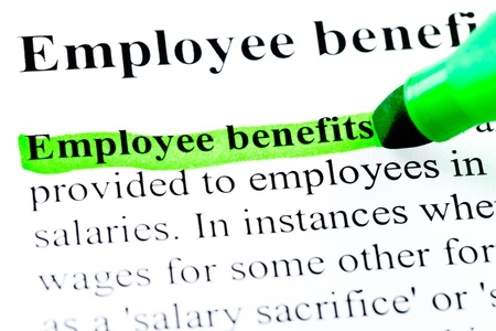 Employee benefits definition highlighted by green marker on white Stock Photo